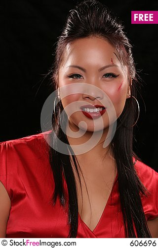 Free Sultry Asian On Black Smiling Royalty Free Stock Image - 606696