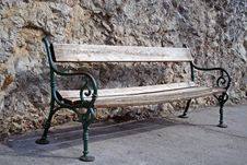 Free Old Bench Against Rock Royalty Free Stock Image - 602746