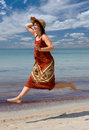 Free Girl In Hat Running At Sea Beach Royalty Free Stock Image - 6008716