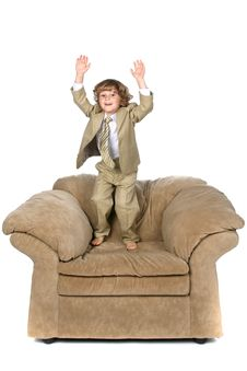 Free Jumping On Chair Boy Royalty Free Stock Photos - 6000778