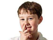 Free Boy Scratching Nose Stock Image - 6001311