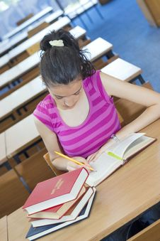Free Young Beautiful Student In College Royalty Free Stock Photography - 6003347