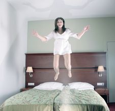 Free Happy Girl Jumping In Bed Stock Image - 6003821