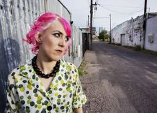 Woman With Pink Hair In An Alley Stock Photos