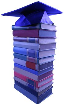 Free Graduation Cap On Top Of Book Pile Royalty Free Stock Photography - 6007307
