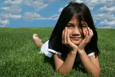 Free Little Girl Lying On Grass Royalty Free Stock Photos - 6007438