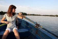 Girl Rowing A Boat Royalty Free Stock Photography