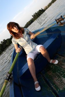 Free Girl Rowing A Boat Stock Image - 6008891