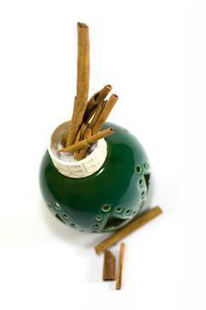 Free Cinnamon Sticks In Green Vase Stock Image - 6012351