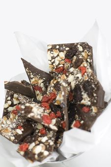 Chocolate Slices With Berries And Nuts Royalty Free Stock Photography