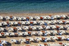Free Empty Chaise Lounges On A Morning Beach Royalty Free Stock Images - 6018769