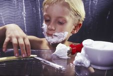 Young Boy With Razor Shaving Stock Photography