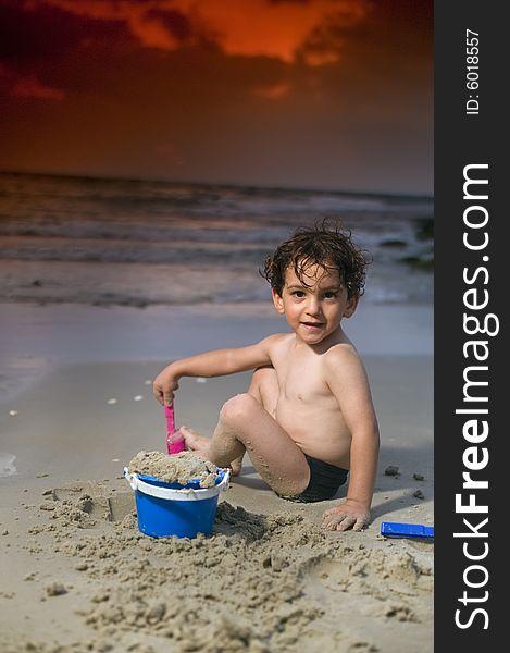 Boy play beach sunset