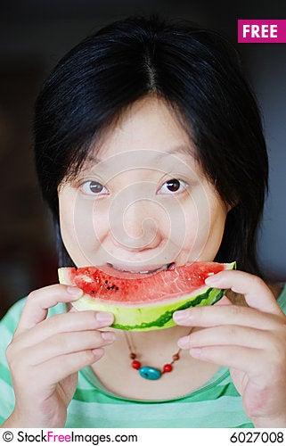 Free A Girl Eat Watermelon Royalty Free Stock Photos - 6027008