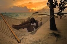 Free Beautiful Woman Lying In Hammock Stock Photography - 6024982