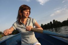 Free Girl Rowing A Boat Stock Photography - 6025202