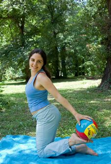 Free Girl Exercising With Ball Outside In Summer Stock Images - 6031224