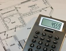 Free Calculator And A House Plan Stock Image - 6033641