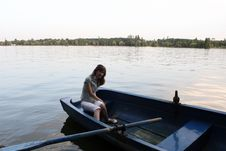 Girl Rowing A Boat Royalty Free Stock Images