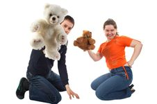 Girl And Young Man Playing With Toys Royalty Free Stock Photos