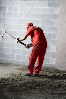 Free Worker Digs With Pick - Vertical Royalty Free Stock Photography - 6040487