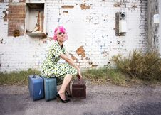 Free Woman With Pink Hair And A Small Siuitcases Royalty Free Stock Photography - 6040597