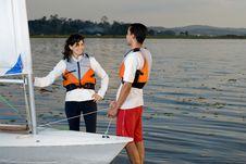 Free Couple Standing Next To Sailboat - Horizontal Stock Photos - 6040773