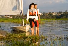 Free Couple Next To Sailboat On Water - Horizontal Stock Photos - 6040823