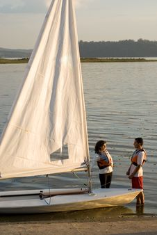 Free Couple Standing Next To Sailboat - Vertical Royalty Free Stock Photos - 6040858