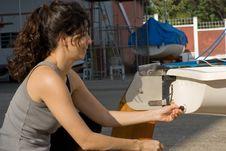 Free Woman Fixing Something On Boat - Horizontal Stock Images - 6040974