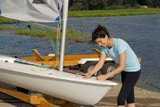Woman Fixing Sail On Sailboat - Horizontal Royalty Free Stock Image