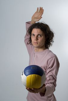 Man In Studio About To Spike Volleyball - Vertical Stock Image
