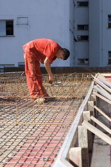 Construction Worker Installs Rebar - Vertical Stock Photo