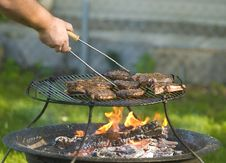 Free Man Barbecuing Meat Royalty Free Stock Images - 6041729