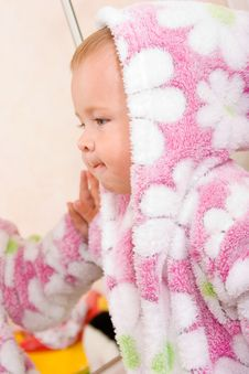 Free Cute Baby With Terry Bathrobe Looking At Mirror Royalty Free Stock Photo - 6048695