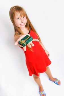 Free Teenager Girl In Red Dress Holding Gift Box Stock Image - 6048921