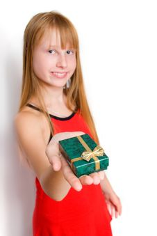 Free Teenager Girl In Red Dress Holding Gift Box Royalty Free Stock Image - 6048926