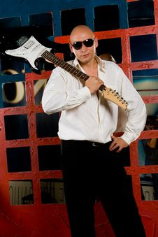 Man With Electric Guitar In Night Club Stock Images