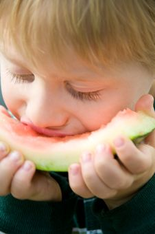 Free Boy Savors Watermelon Royalty Free Stock Images - 6049969