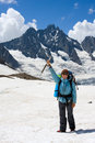 Free Smiling Backpacker Woman With Ice-axe Royalty Free Stock Photos - 6051138