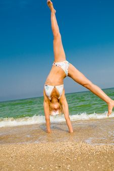 Free Girl Exercising At Sea Beach Stock Photo - 6050150