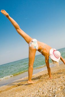 Free Girl Exercising At Sea Beach Royalty Free Stock Photography - 6050157