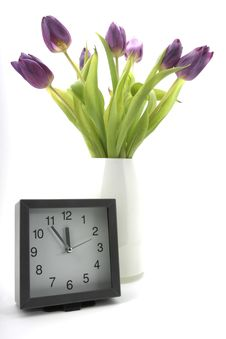 Clock With Blooms Of Tulips Stock Image