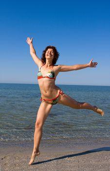 Free Happy Smiling Girl Jumping At Sea Beach Royalty Free Stock Photos - 6051258
