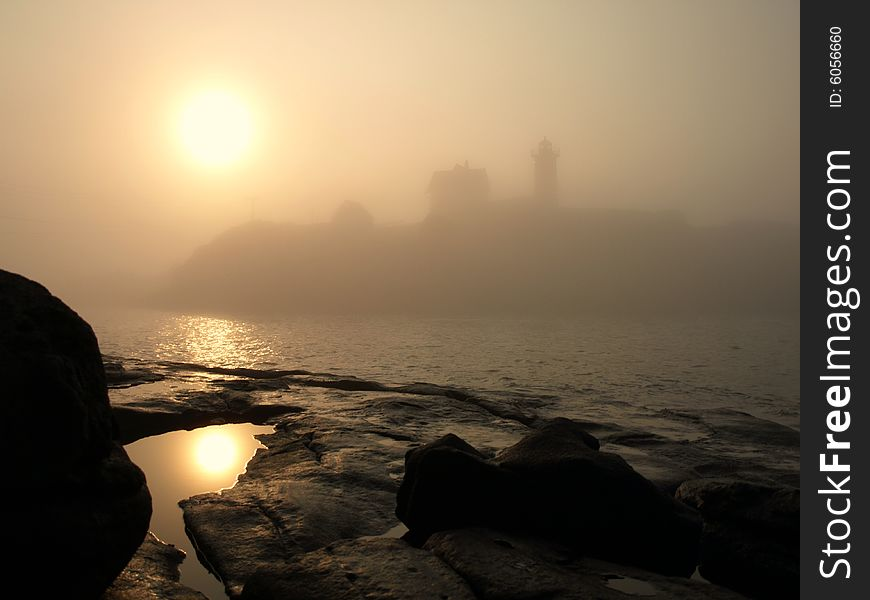 Foggy Sunrise at Lighthouse on the Ocean