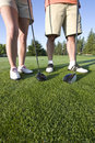 Free Man And Woman With Clubs - Vertical Royalty Free Stock Photography - 6069267