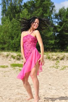 Free Happy Woman Dancing On The Beach Stock Images - 6061564
