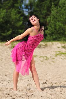 Free Happy Woman Dancing On The Beach Stock Photo - 6061570
