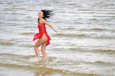 Free Happy Woman Dancing On The Beach Stock Photo - 6061580