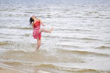 Free Happy Woman Dancing On The Beach Stock Photo - 6061600